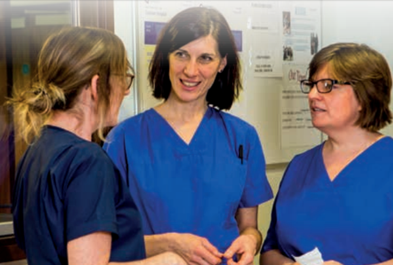 Midwives talking at work